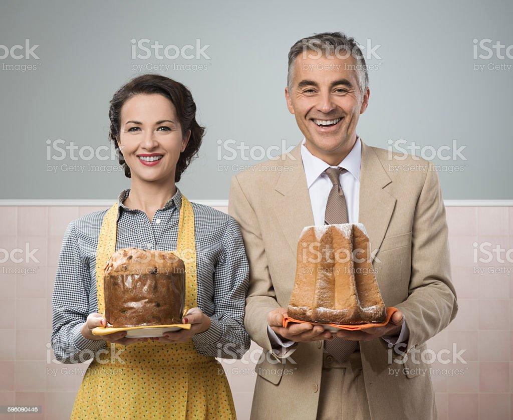 Smiling vintage couple with cakes royalty-free stock photo