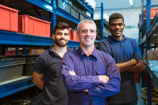 Smiling Warehouse Workers Standing In Storage Room Stock Photo - Download Image Now