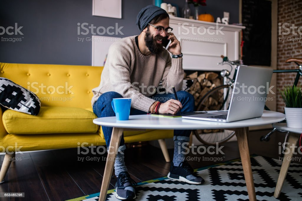 Smiling webdesigner working from his home office stock photo