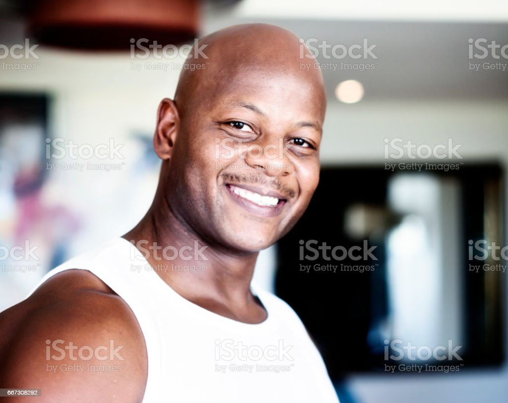 Smiling, well-muscled man of African descent stock photo