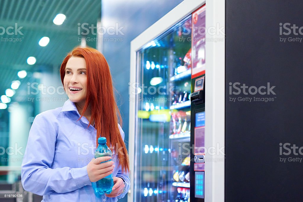 smiling while picking up my water stock photo