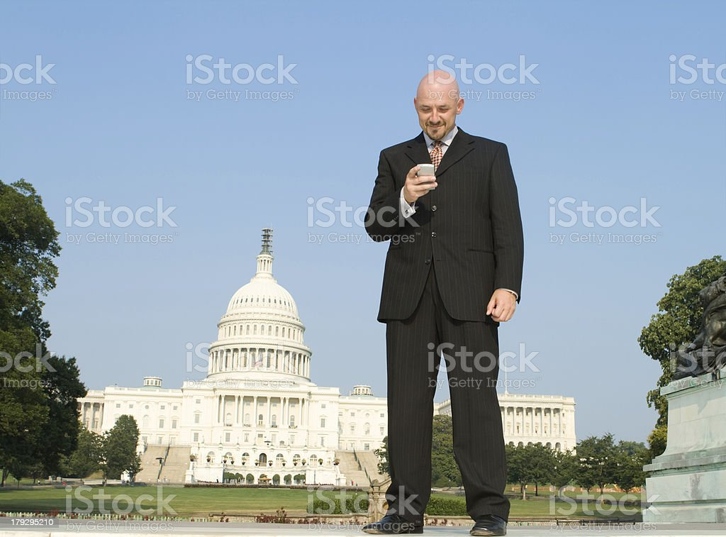 Smiling White Lobbyist Standing Front U.S. Capitol Building, Blue Sky royalty-free stock photo