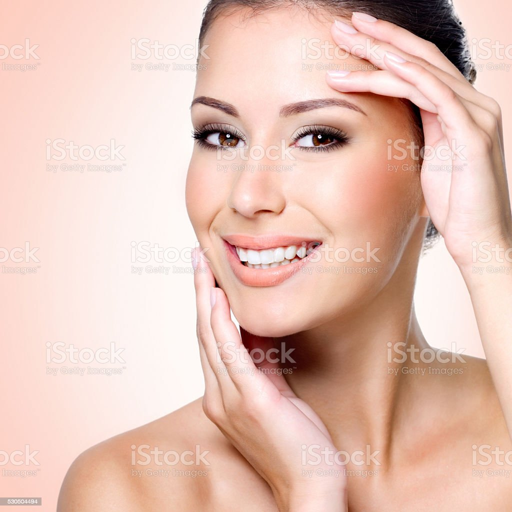Smiling white woman with healthy skin of face stock photo