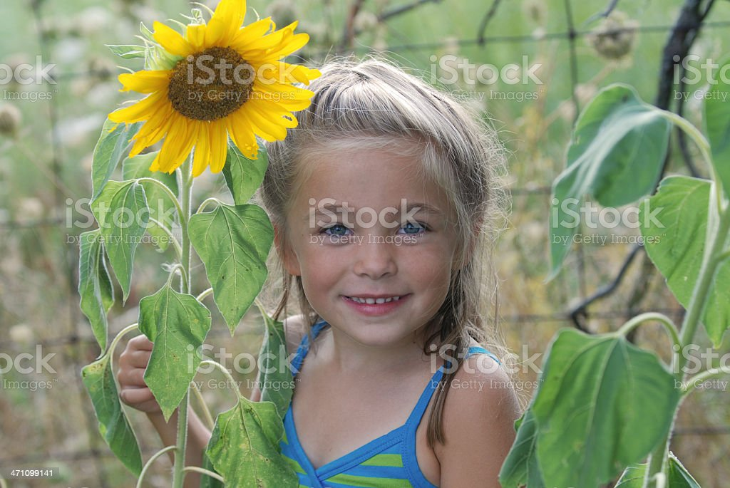 Smiling with a Sunflower stock photo
