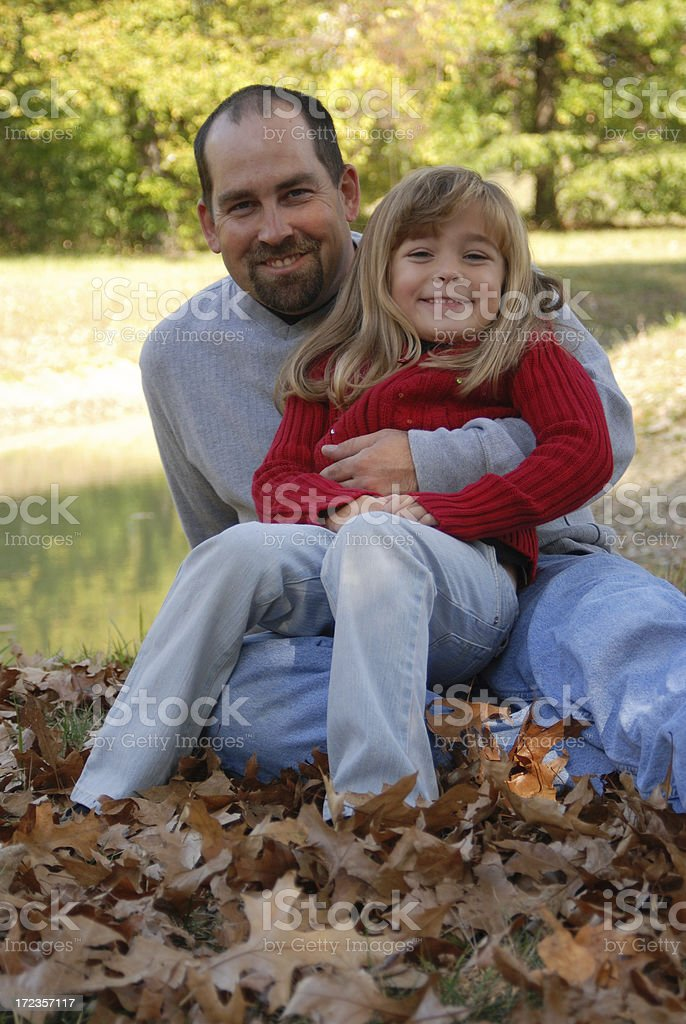 Smiling with Daddy in the Leaves royalty-free stock photo