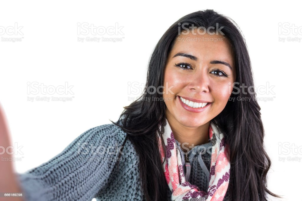 Smiling woman about to take a selfie stock photo