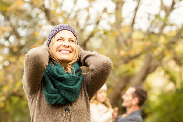 Smiling woman against her husband and her daughter Smiling woman against her husband and her daughter on an autumns day 40 44 years stock pictures, royalty-free photos & images