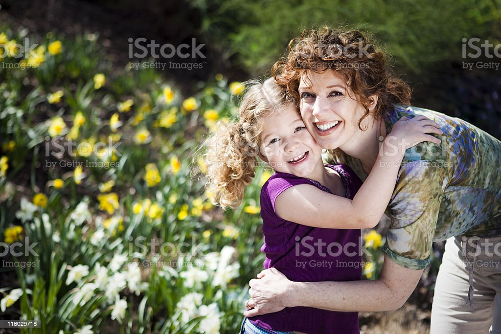 Smiling woman and child in embrace outdoors royalty-free stock photo