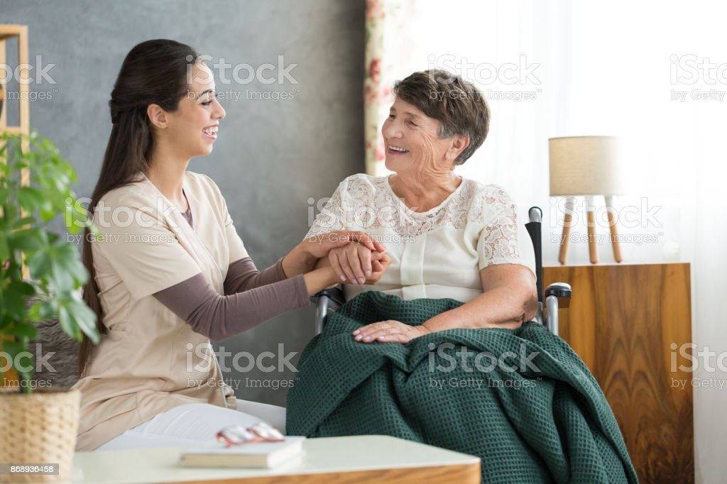 Smiling woman and happy grandmother stock photo