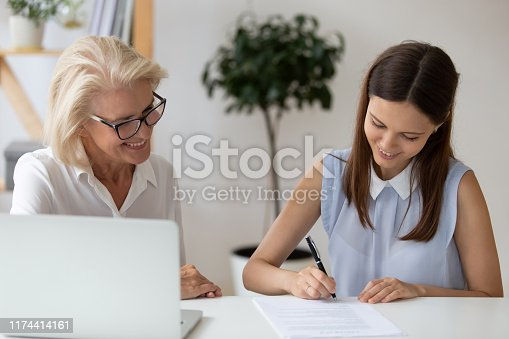 istock Smiling woman applicant sign contract with business partner 1174414161