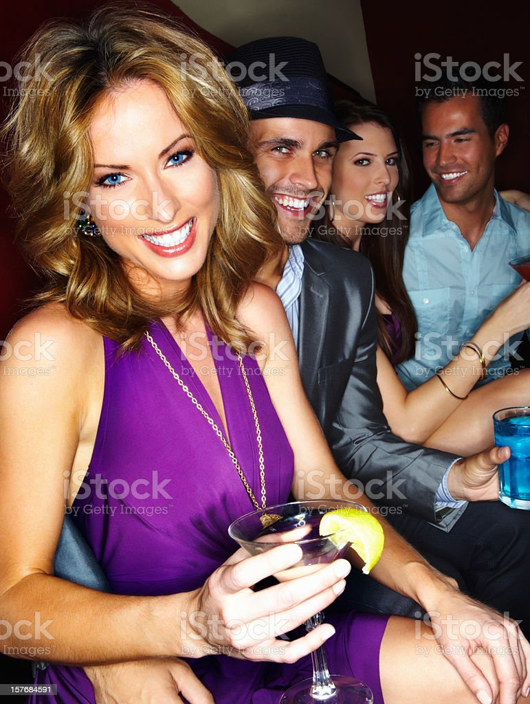 Smiling woman at cocktail party with friends royalty-free stock photo