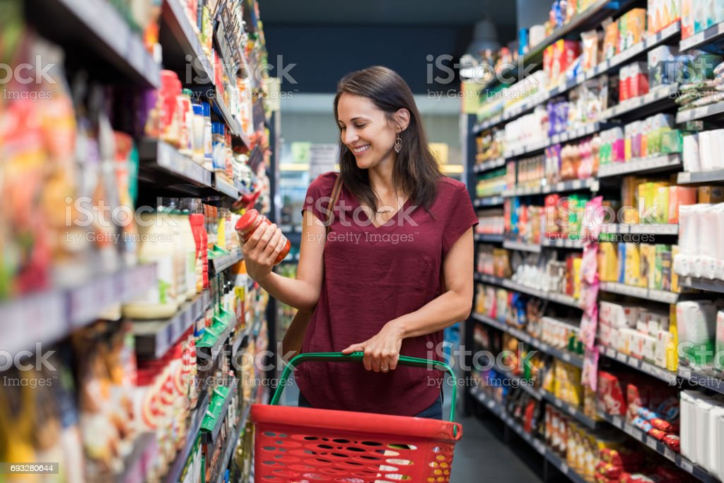 Smiling woman at supermarket stock photo