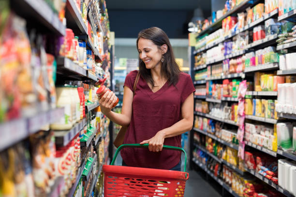 smiling woman at supermarket - shopping stock photos and pictures