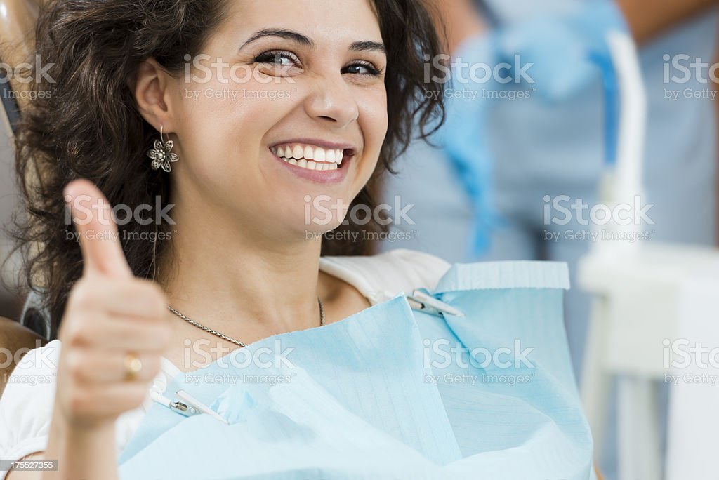 Smiling woman at the dentist stock photo