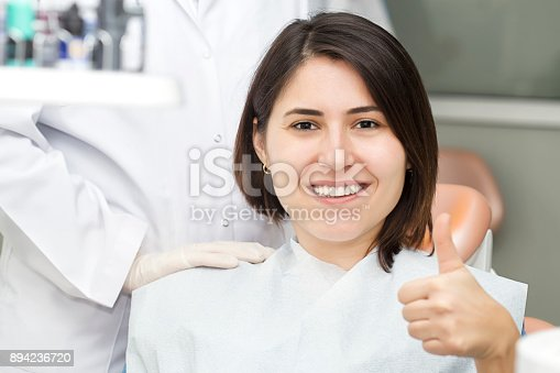 1035479448 istock photo Smiling woman at the dentist 894236720