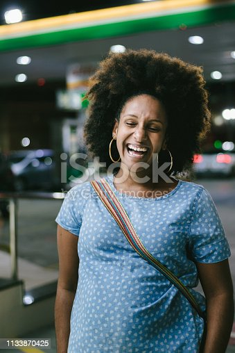 624206636 istock photo Smiling woman at the gas station 1133870425
