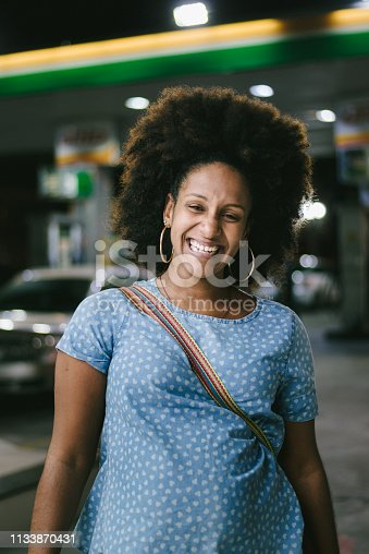 624206636 istock photo Smiling woman at the gas station 1133870431