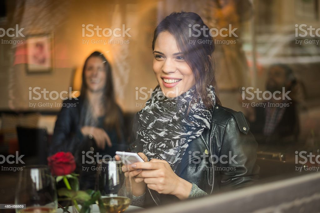 Smiling woman behind the restaurant window royalty-free stock photo