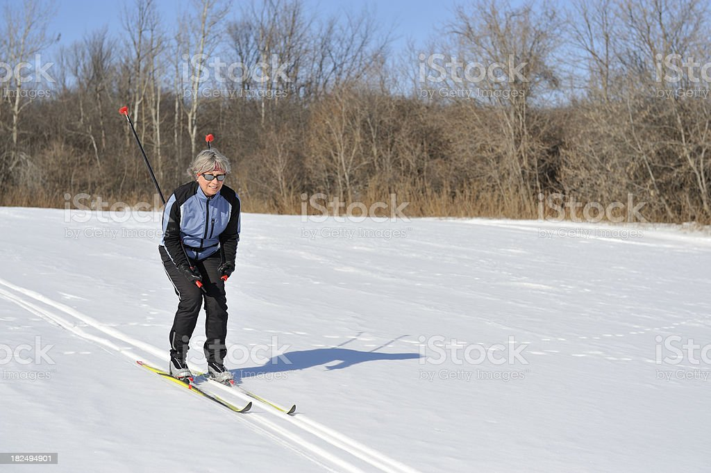 Smiling Woman cross-country skiing, winter sport royalty-free stock photo