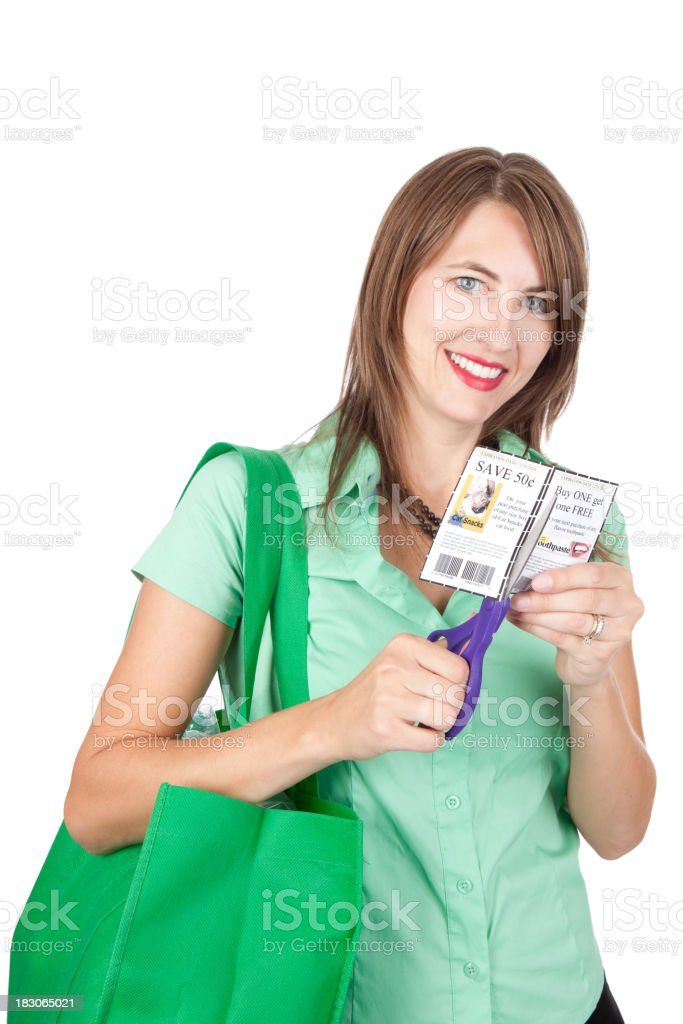 Smiling Woman Cutting Coupons stock photo