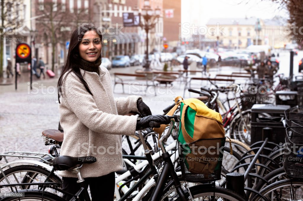 Smiling woman cycling in Helsingborg стоковое фото