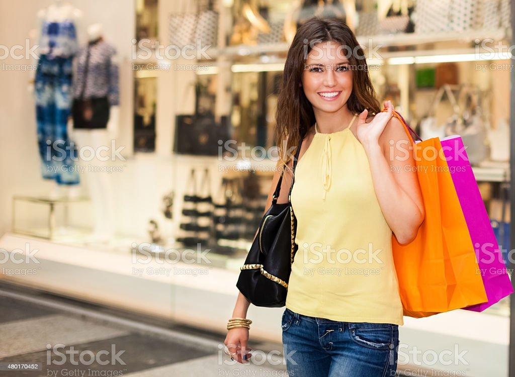 Smiling woman doing shopping stock photo