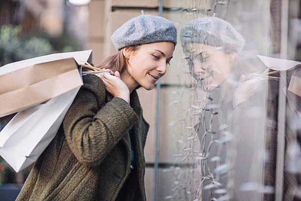 Smiling woman doing window shopping stock photo