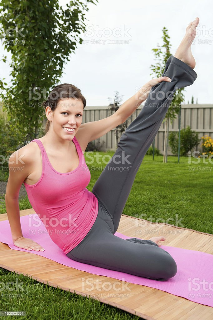 Smiling Woman Doing Yoga Outdoor Stock Photo - Download ...