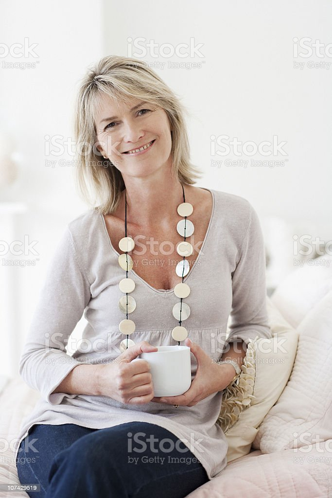Smiling woman drinking coffee stock photo