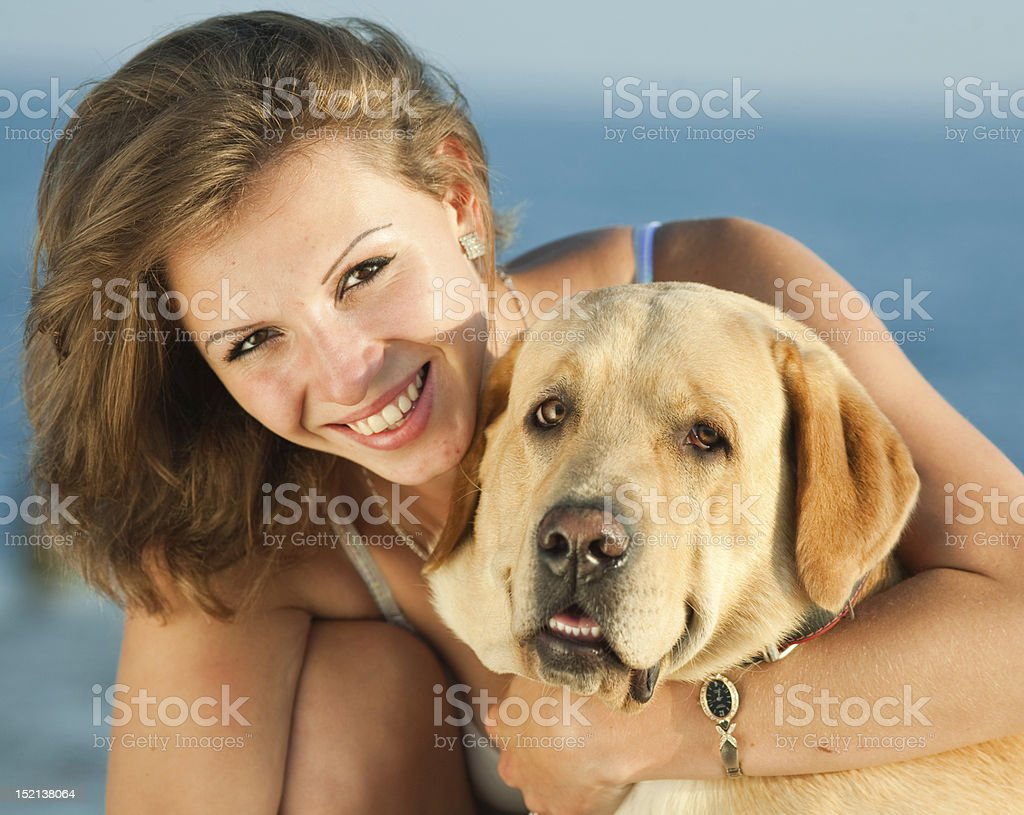 Smiling woman embracing her labrador royalty-free stock photo