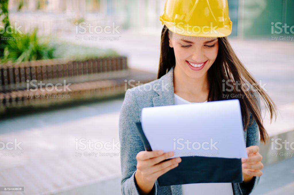 ab4d0474c04 Smiling Woman Engineer Wearing Yellow Helmet Stock Photo   More ...