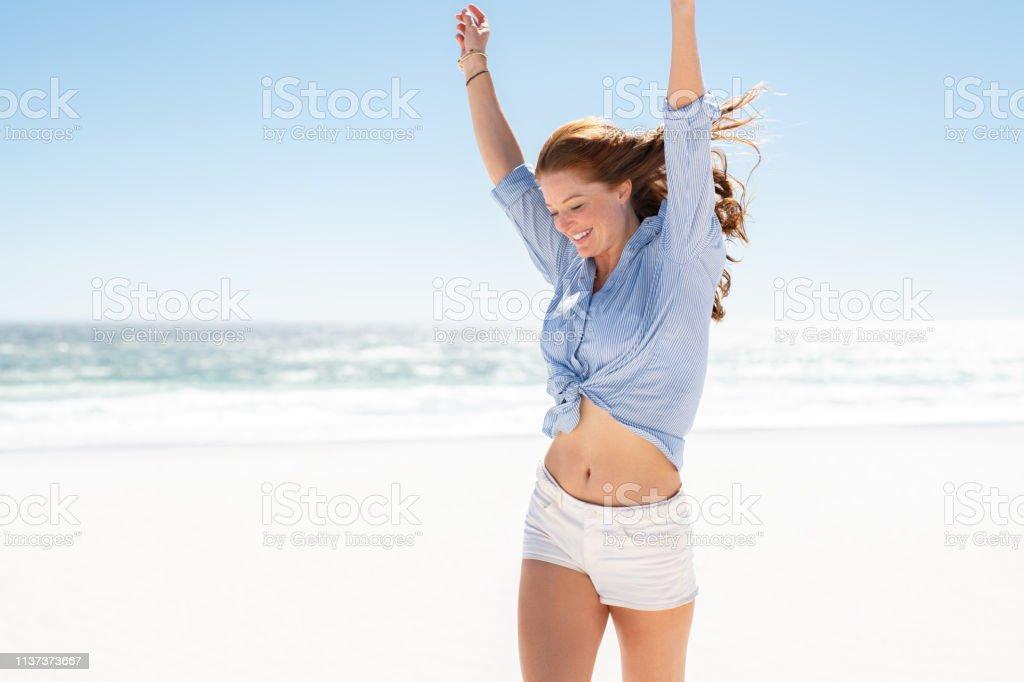 Smiling woman enjoying the beach royalty-free stock photo