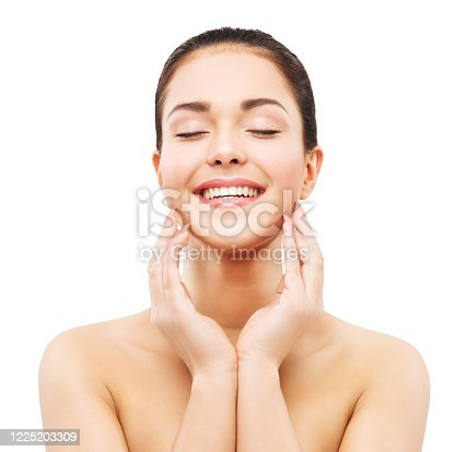 Smiling Woman Face Skin Care, Natural Beauty Makeup, Happy Laughing Girl Touching Face by Hands, isolated on White background