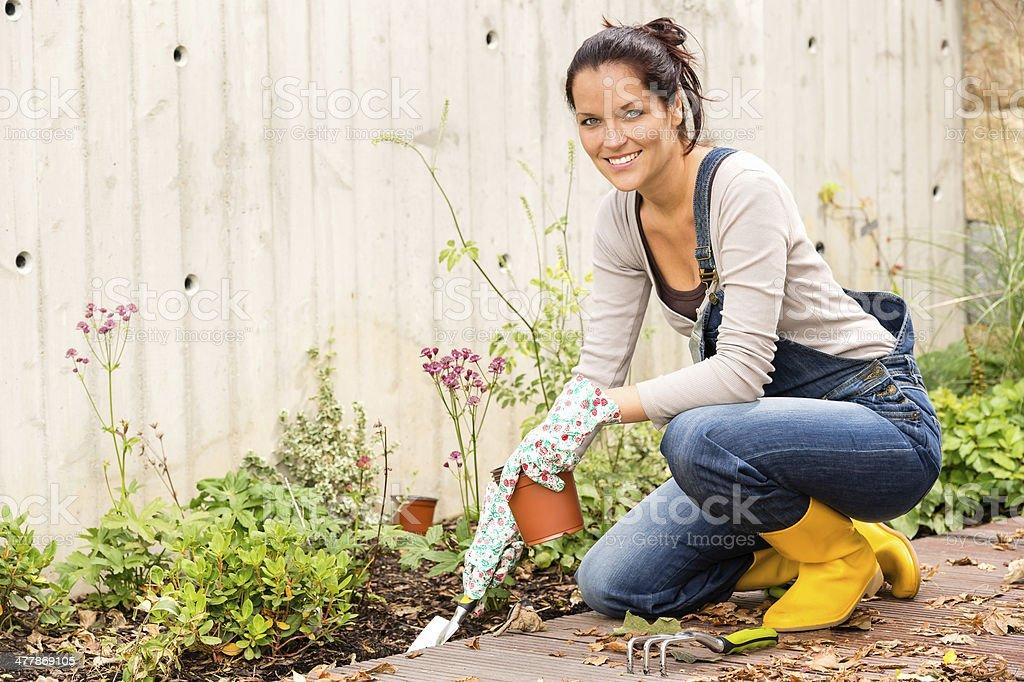 Smiling woman gardening backyard hobby small tools stock photo