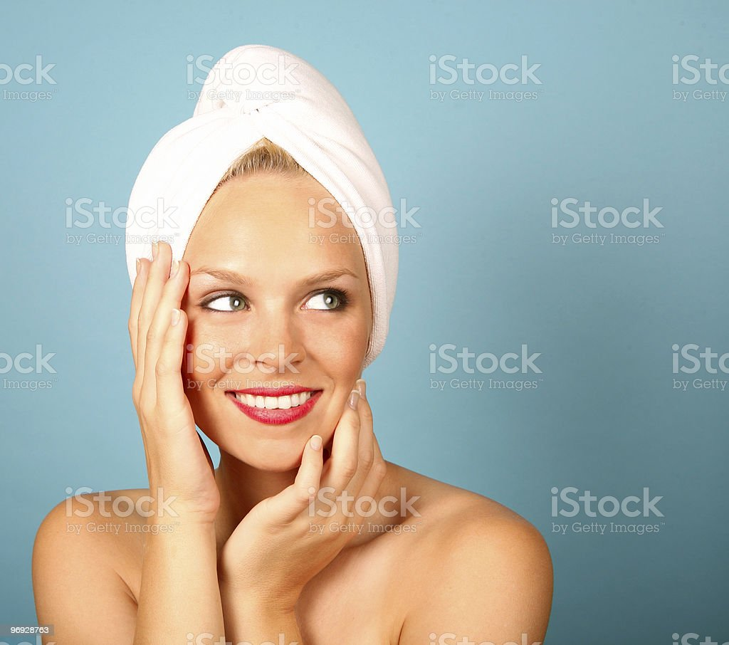 Smiling Woman Getting a Facial Treatment royalty-free stock photo