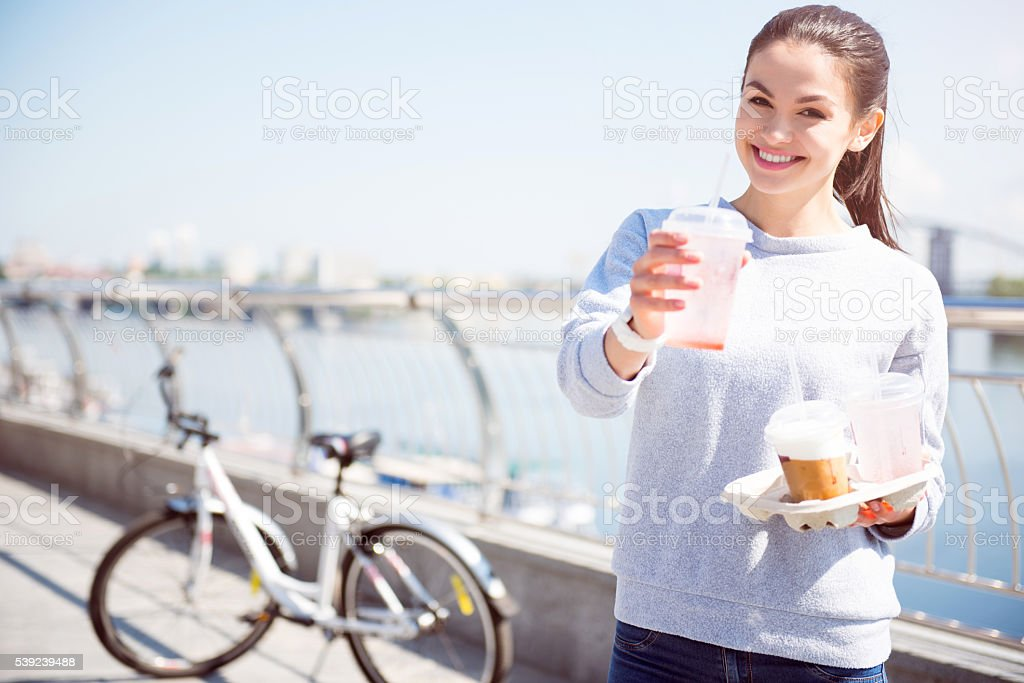 Smiling woman giving a beverage royalty-free stock photo