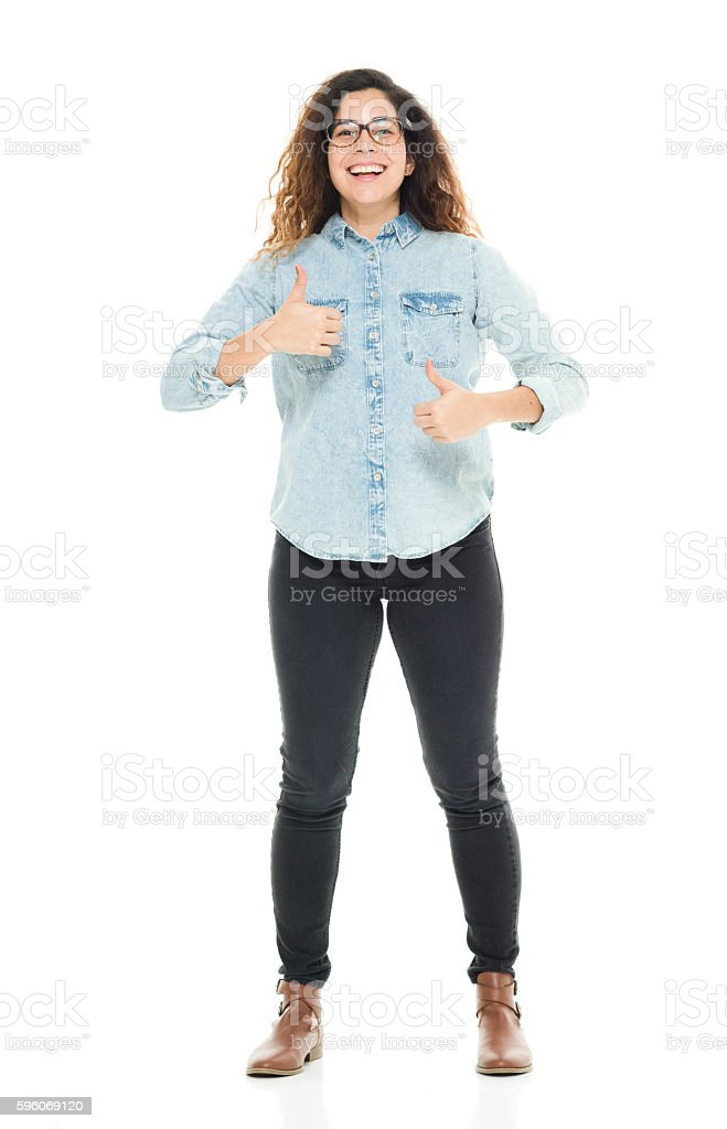 Smiling woman giving thumbs up royalty-free stock photo