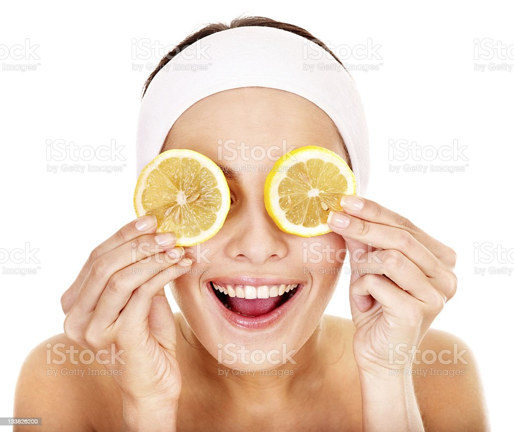 A smiling woman having a fruit facial royalty-free stock photo