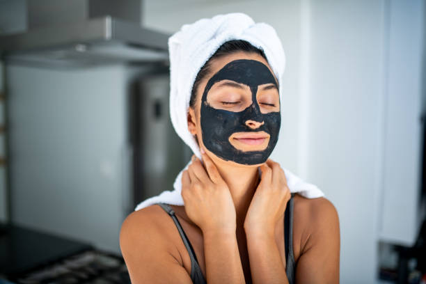 Smiling woman having a spa day at home. stock photo