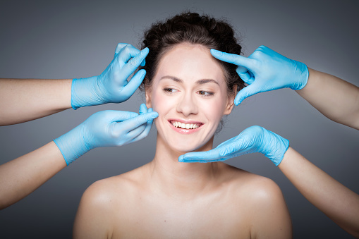 istock Smiling woman having skin checkup before plastic surgery. 917711644