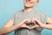 smiling woman heart shape hands love feelings