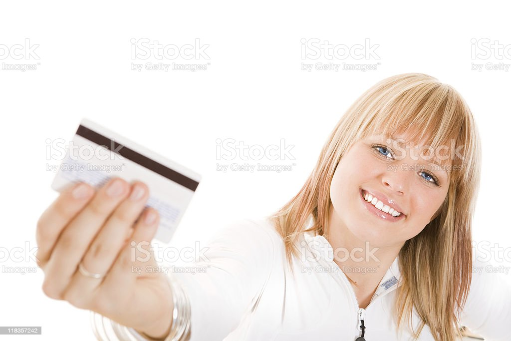 Smiling woman holding a credit card royalty-free stock photo