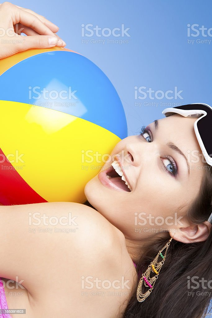 Smiling woman holding beach ball royalty-free stock photo