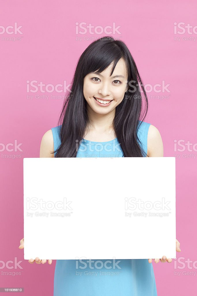 Smiling woman holding billboard royalty-free stock photo
