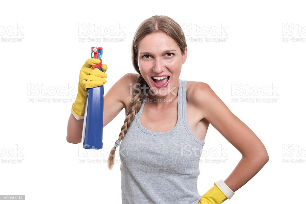 Smiling woman holding bottle of chemistry for cleaning house stock photo