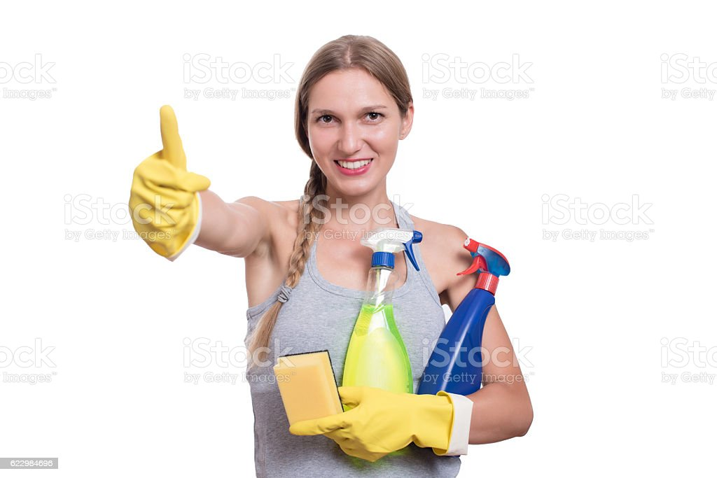 Smiling woman holding bottles of chemistry for cleaning house stock photo