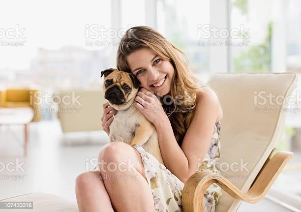 Smiling woman holding cute small dog on lap picture id107430016?b=1&k=6&m=107430016&s=612x612&h=isdm ijuaiskgdhmfv09tdqsxmxi7wrqk4tr7qapkco=