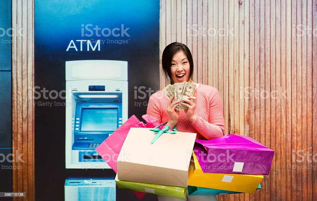 Smiling woman holding excited by money stock photo