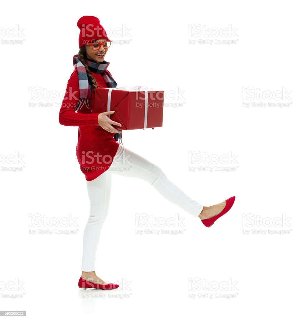 Smiling woman holding gift box royalty-free stock photo
