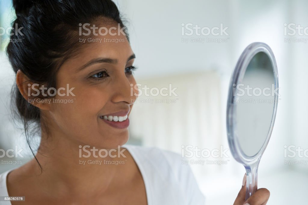 Smiling Woman Holding Hand Mirror Stock Photo More Pictures of 20